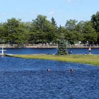 Kids swimming in Rideau River on a warm windy day in Smiths Falls