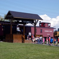 Kids getting on a tour train at the Science and Technology Museum