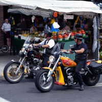Bikers stopped in front of a fruit stand in the By Ward Market