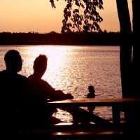 Family enjoying a sunset beside the Ottawa River