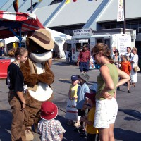 Kids being greeted at Ottawa`s SuperEx by a big squirrel