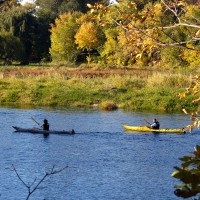 Couple kayaking on the Rideau River during fall