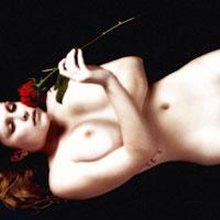 Figure model lying down with a rose
