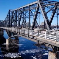 Icy Ottawa River under inter provincial Alexandra Bridge