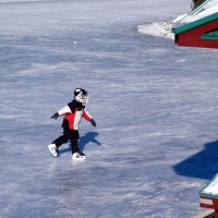 Young boy skating on the Rideau Canal