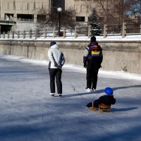 Family skating on the Rideau Canal