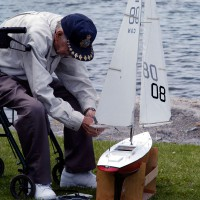 Man working on his remote controlled sail boat