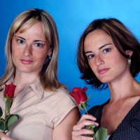 Twin sisters posing with roses