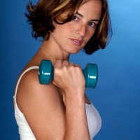 Woman lifting dumbbell weights