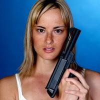 Sexy woman holding a gun