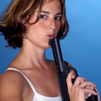 Woman cooling down her gun