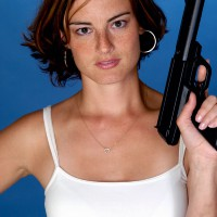 Woman with gun in her hand