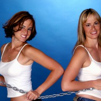 Two women pulling on a chain