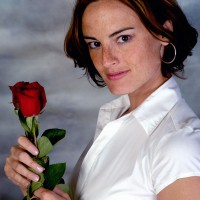 Beautiful woman posing with a rose