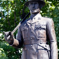Statue of soldier with a sword on his shoulder