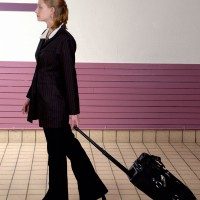 Woman walking with carryon luggage