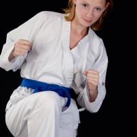 Woman doing karate kick
