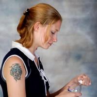 Woman opening a water bottle