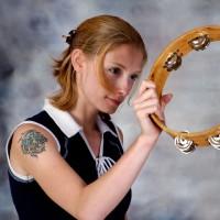 Woman playing tambourine