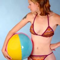 Woman in bikini with a beach ball