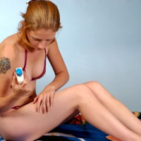 Woman applying sun screen lotion