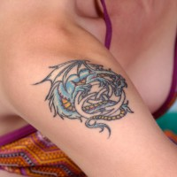 Dragon tattoo on women`s shoulder