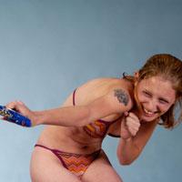 Woman in water pistol fight