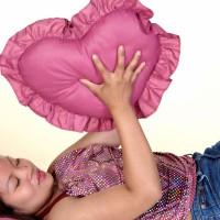 Girl holding heart shape pillow
