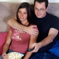 Couple with popcorn watching TV