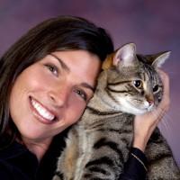 Women cuddling her cat