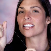 Woman with holding a floss string