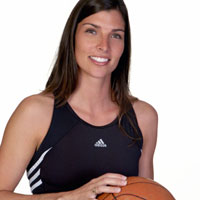 Athletic woman holding a basketball