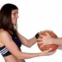 Woman pulling a basketball