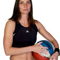 Athletic women holding a basketball