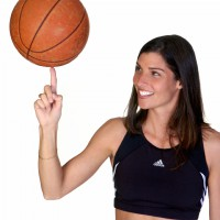 Woman balancing a basketball on her finger