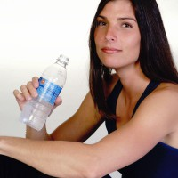 Athletic woman with a bottle of water