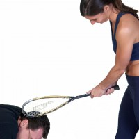 Woman hitting man`s head with a racquetball racket