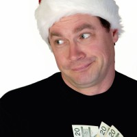 Man in Santa Claus toque with money