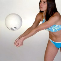Women in swimsuit playing volleyball