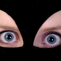 Closeup of women`s eyes in cat mask