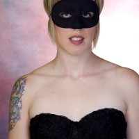 Woman in black bustier and mask