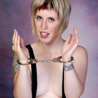 Topless woman in handcuffs