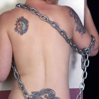 Tattooed woman chained