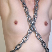 Topless woman chained