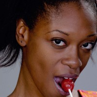 Woman eating a tootsie pops