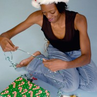 Woman wrapping chriWoman wrapping Christmas present stmas present
