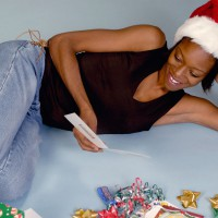 Woman reading a Christmas card