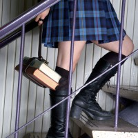 School girl with books walking up stairs