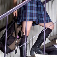 Girl with backpack walking up stairs