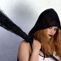 Gothic girl with a witch`s broom
